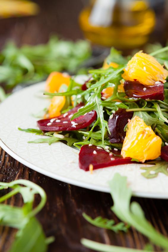 fresh salad with arugula and citrus, healthy food
