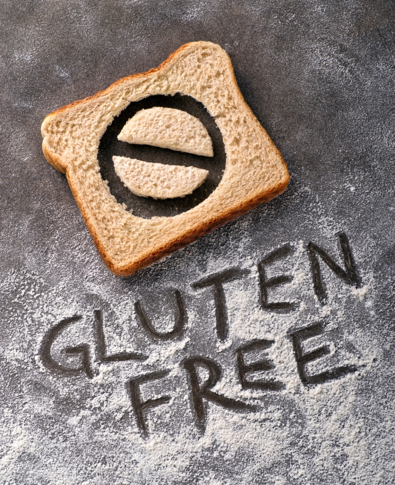 Gluten free bread with symbol and caption written in flour.